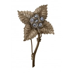 Gold tone flower brooch with crystals