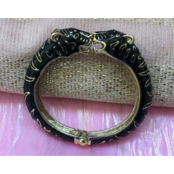 Two panther heads cloisonné enamelled gold tone black bracelet