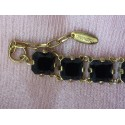Chunky Witchery gold tone black glass bracelet