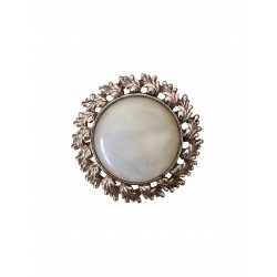Gold tone moonstone cabochon brooch