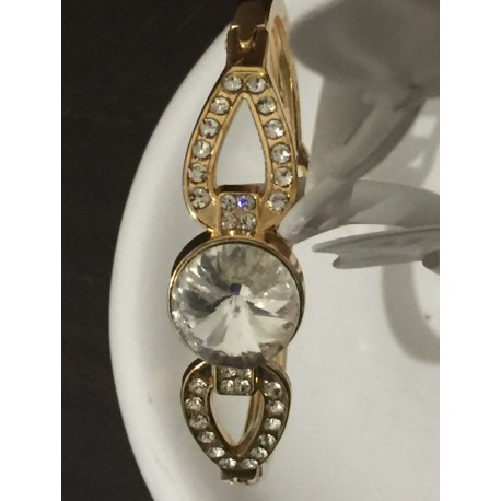 Solitaire faceted crystal gold tone bracelet surrounded by crystals
